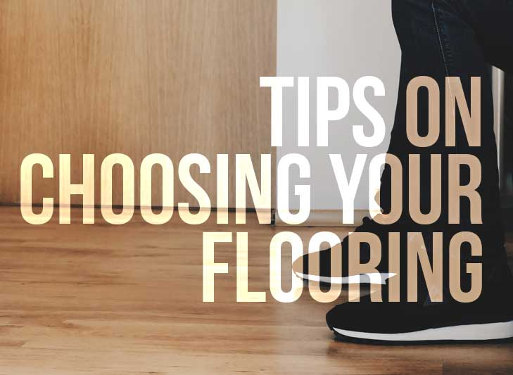 words Tips on choosing your flooring is overlayed on an image of a man's shoe on hardwood floor